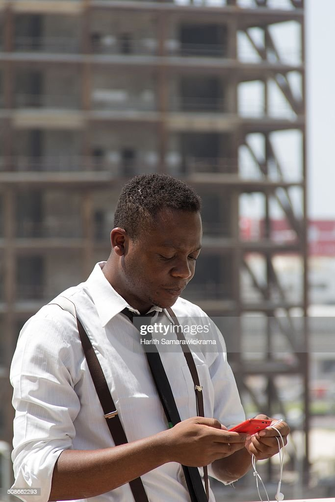 An African man using a phablet
