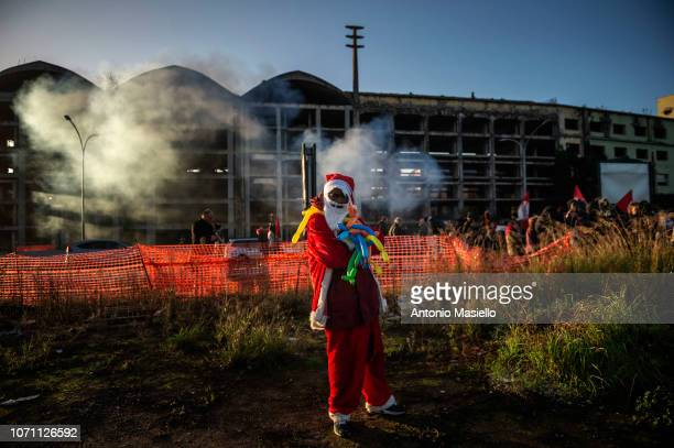 An African migrant dressed as Santa Claus stays out the abandoned penicillin factory during the evacuation on December 10 2018 in Rome Italy...