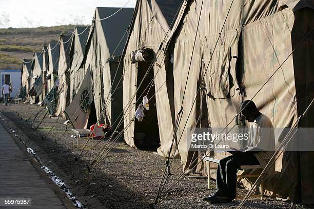An African migrant is seen at the CETI Short Stay Immigrant Center on October 20 2005 in the Spanish Enclave of Melilla Spain Several migrants were...