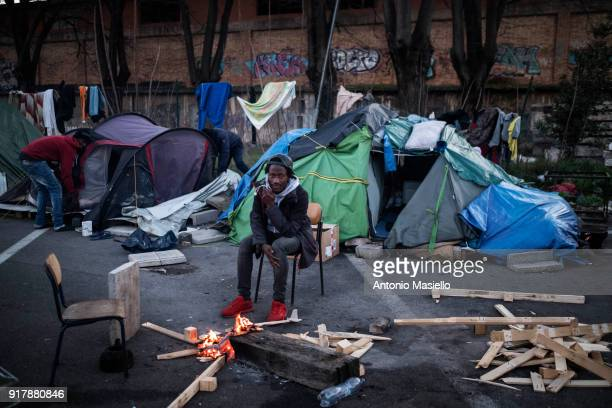An African migrant lives in the makeshift camp for migrants and refugees despite the low temperatures during the winter season on February 13 2018 in...