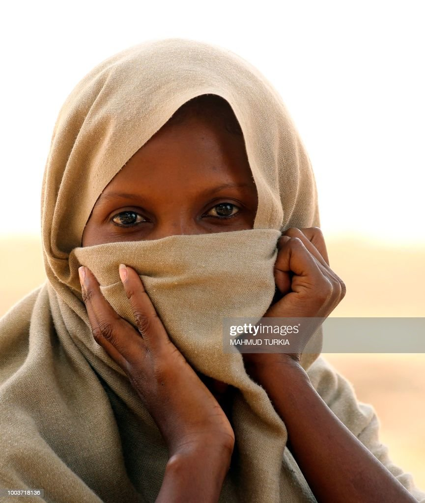 An Illegal African migrant looks on at an Anti-Illegal Immigration Authority shelter in Ain Zara in the Libyan capital Tripoli on July 22, 2018.