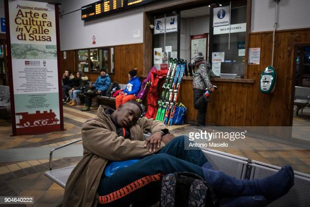 An African migrant sleeps in the railway station on January 13 2018 in Bardonecchia Italy With the the closure of the French border in Ventimiglia...