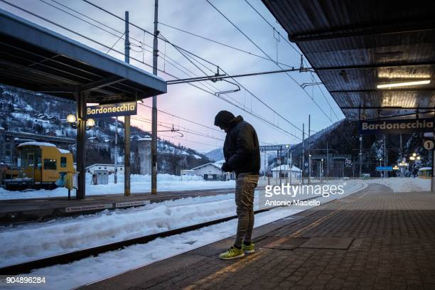An African migrant stands at the railway station on January 14 2018 in Bardonecchia Italy With the the closure of the French border in Ventimiglia...
