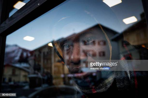 An African migrant wait in the railway station to try to cross the border between France and Italy on January 13 2018 in Bardonecchia Italy With the...