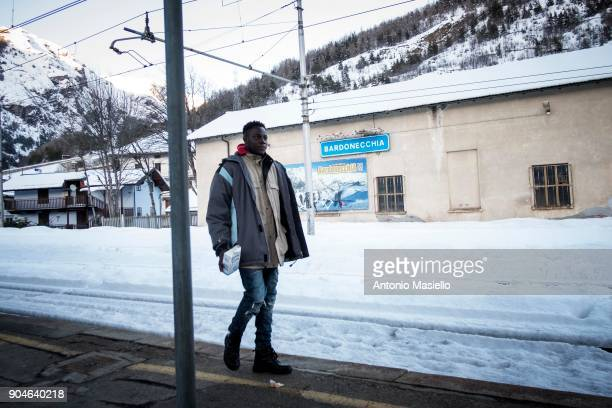 An African migrant walks in the railway station on January 13 2018 in Bardonecchia Italy With the the closure of the French border in Ventimiglia...