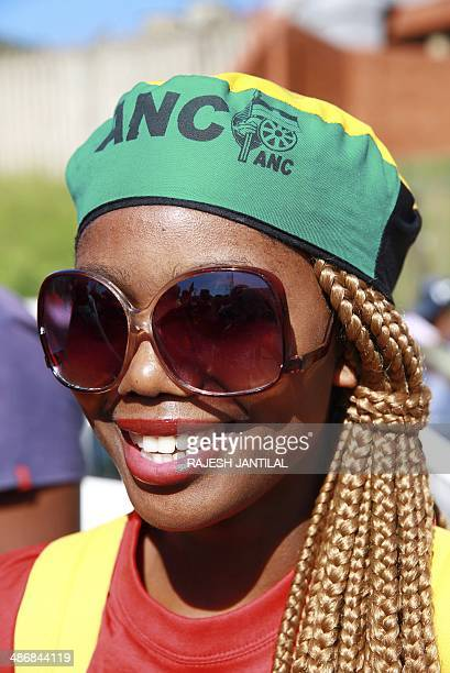An African National Congress female member wears colourful ANC regalia during a march organised by the Congress of South African Trade Unions to...