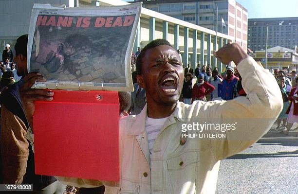 An African National Congress supporter holds a picture 13 April 1993 of Chris Hani the South African Communist Party leader who was killed 10 April...