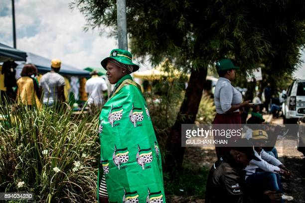 TOPSHOT An African National Congress supporter in ANC attire looks on outside the 54th ANC national congress on December 17 2017 in Johannesburg...