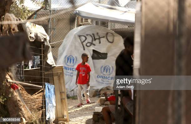 An African refugee child walks through the Moria refugee camp on May 20 2018 in Mytilene Greece Despite being built to hold only 2500 people the camp...