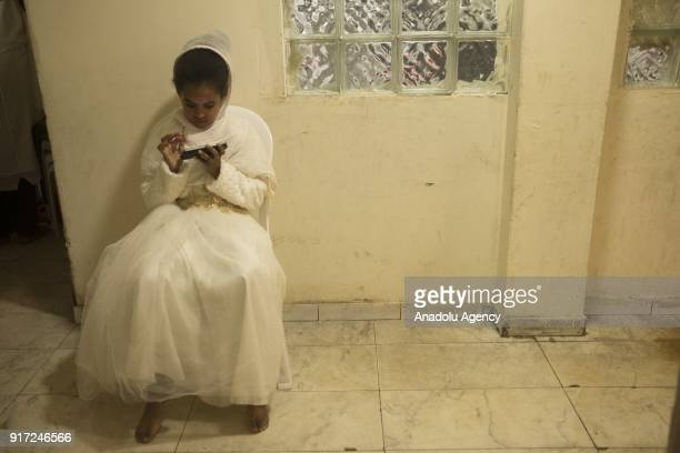 An African refugee girl who lives in Israel is seen inside a house with her mobile phone in Tel Aviv Israel on February 10 2018 Israeli government...