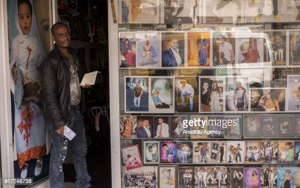 An African refugee man who lives in Israel is seen in front of a photo studio in Tel Aviv Israel on February 10 2018 Israeli government offers an...