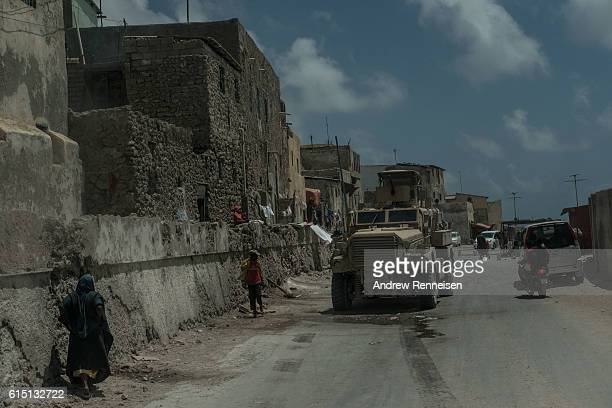An African Union armored personnel carrier moves through a street on October 13 2016 in Mogadishu Somalia Somalia is on the brink of its first...