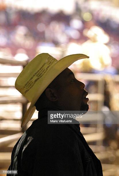 An AfricanAmerican cowboy looks at a list to find out what horse he drew for Bronco Horse finals of National Black Rodeo Finals on November 13 2004...