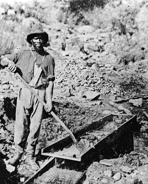 An African-American miner poses with a shovel in Auburn...