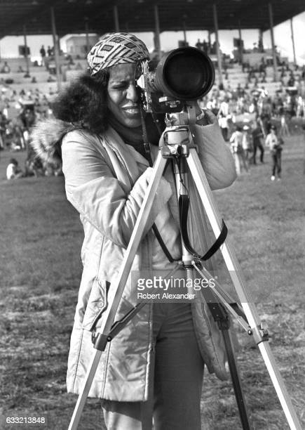 An AfricanAmerican photojournalist prepares to photograph the launch of the Space Shuttle Columbia at Kennedy Space Center in Florida on November 12...