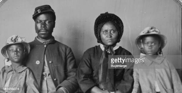 An African-American soldier in uniform with his wife and two daughters, circa 1864. In May 1863, U.S. Secretary of War Edwin Stanton issued General...
