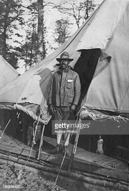An AfricanAmerican soldier of the US Army outside his tent in SaintDizier Haute Marne northeastern France circa 1918
