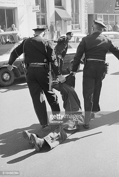 An AfricanAmerican student Willie Lawrence McRae a member of the Student NonViolent Coordinating Committee of Atlanta Georgia is dragged by two Selma...