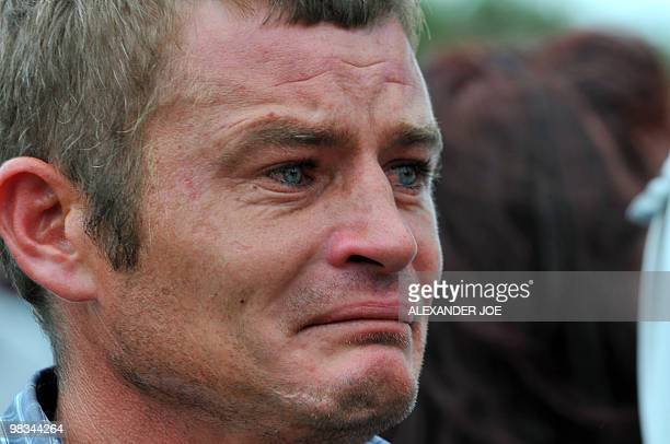 An Afrikaner Resistance Movement member cries during the funeral of AWB leader Eugene Terre'Blanche at a church in Ventersdorp on April 9 2010...