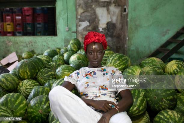 an afro-brazilian woman visits the são joaquim market in salvador. - showus stock pictures, royalty-free photos & images