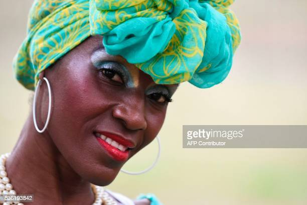 An AfroColombian woman is pictured during the XXI Pacific Music Festival Petronio Alvarez in Cali Colombia on August 20 2017 The Petronio Alvarez...