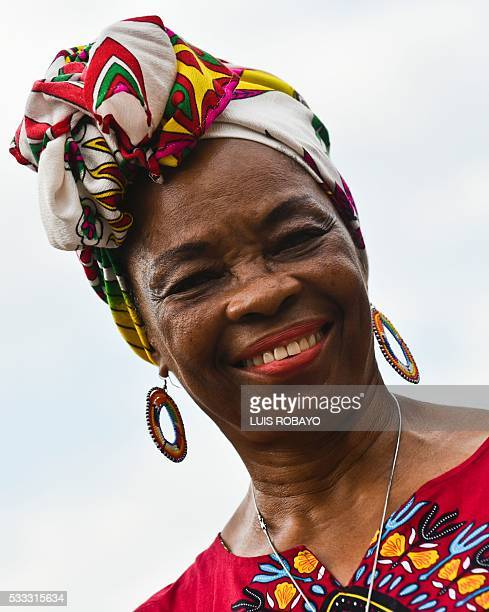 An AfroColombian woman poses for a photo on AfroColombian Day on May 21 in Cali Colombia celebrating the 165th anniversary of the abolition of...