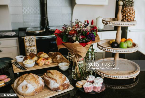 an afternoon tea laid across a kitchen counter - spread stock pictures, royalty-free photos & images