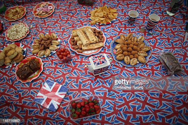 An afternoon tea party laid out by revellers on the The Mall as thousands gather for The Diamond Jubilee Concert on June 4 2012 in London England For...