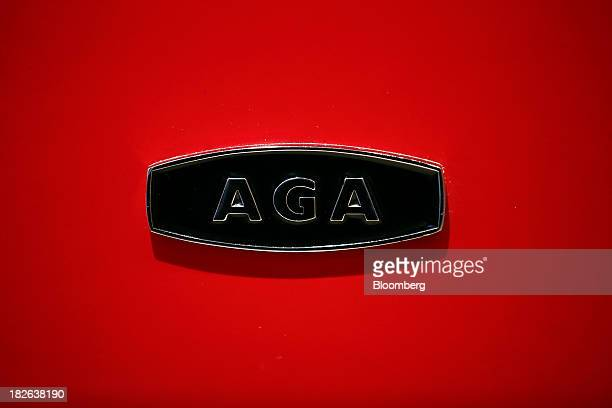 An AGA logo sits on the door of an S series range cooker produced by AGA Rangemaster Plc at the company's plant in Telford UK on Tuesday Oct 1 2013...