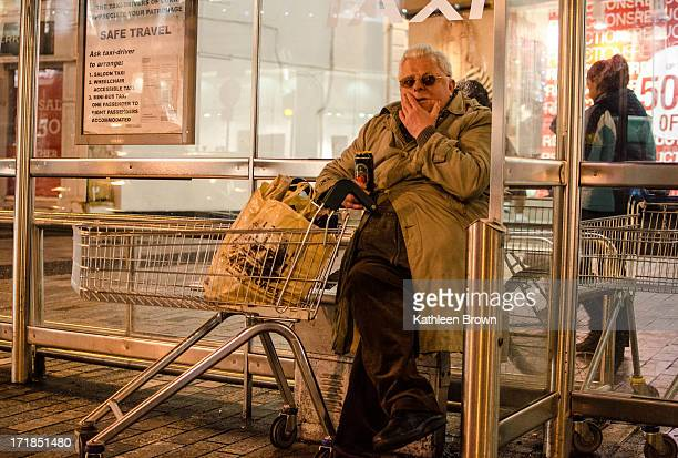An age old relationship exists between the human and canine. Hair of the dog, drinking in the street, old man drinking with trolley. Street...