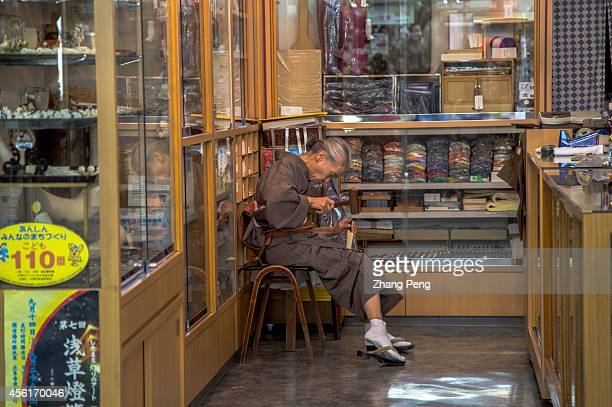 An aged woman is making traditional handicraft goods in her little shop outside Asakusa temple The number of people aged 65 or older in Japan will...