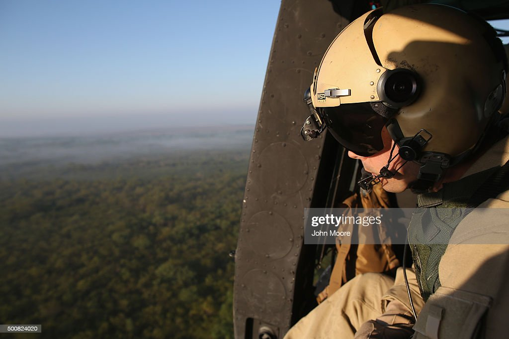 An agent from U.S. Air and Marine Operations (AMO), looks for undocumented immigrants while flying near the U.S.-Mexico border on December 10, 2015 at La Grulla, Texas. The number of families and unaccompanied minors illegally crossing the border from Central America into Texas' Rio Grande Valley has surged in recent months. Border security remains a key issue in the U.S. Presidential campaign.