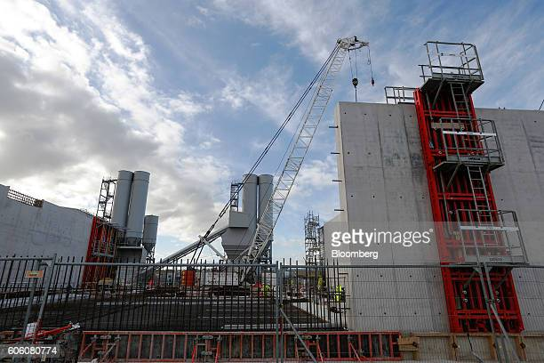 An aggregate silo stands under construction in front of the concrete batching plant at the Hinkley Point C nuclear power station operated by...