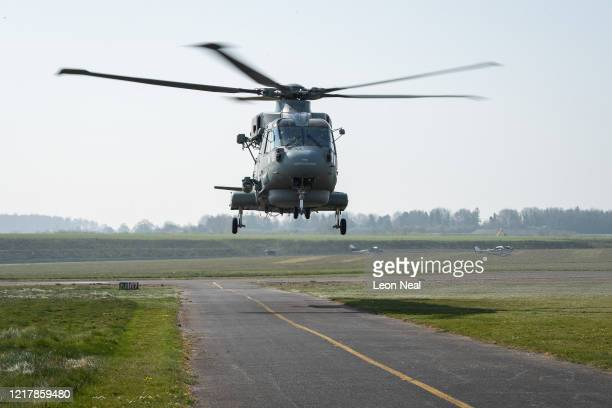 An AgustaWestland AW101 Merlin helicopter comes into land as members of the UK Armed Forces work with NHS medical staff and Air Ambulance Service...