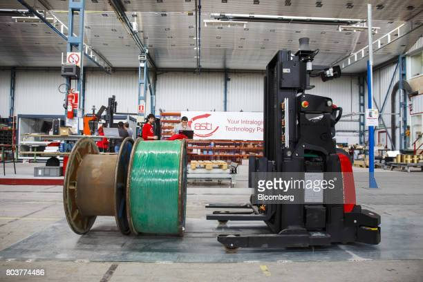 An AGV Robofast mobile robot also known as an AGV or automated guided vehicle collects a spool during testing inside the Automatismos y Sistemas de...