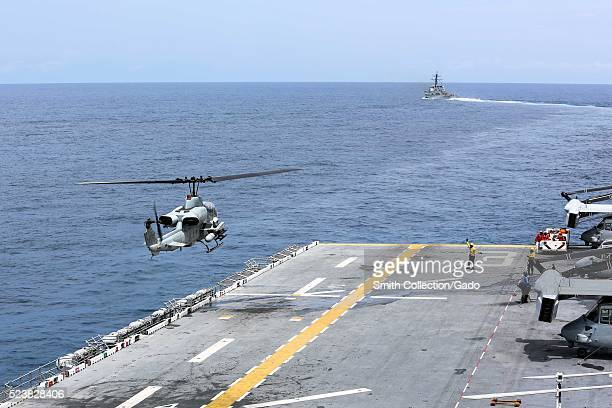 An AH1 Cobra helicopter lands on the flight deck of the amphibious assault ship USS Kearsarge LHD 3 Atlantic Ocean Image courtesy Mass Communication...