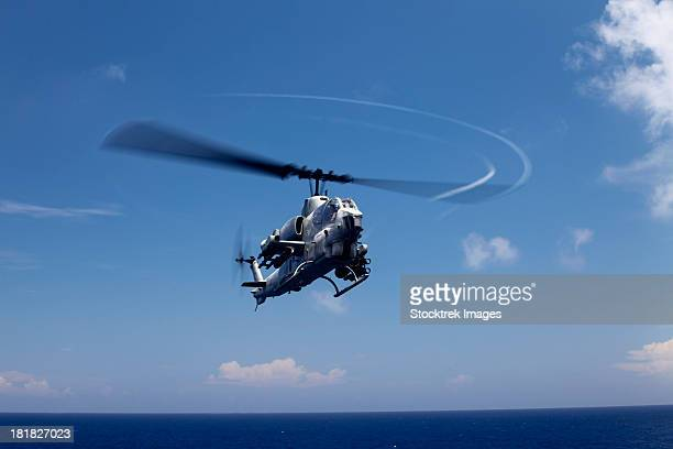 An AH-1 Cobra in flight over the Philippine Sea.