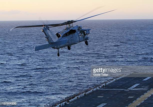 An AH1W Cobra aircraft elevates after taking off from the USS Bataan on January 13 2012 near Catania Italy The Bataan part of the Amphibious...