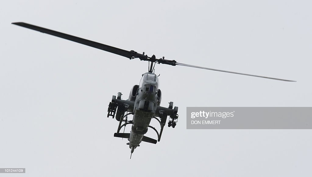 An AH-1W Cobra flies overhead as the US Marines conduct a public helicopter demonstration May 28, 2010 at Orchard Beach, Bronx, NY. The event was one of many held this week as New York City celebrates Fleet Week.