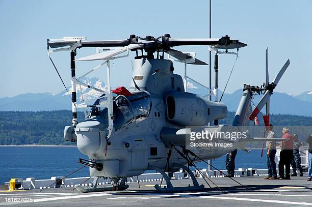 An AH-1W Cobra is chained to the flight deck of USS Bonhomme Richard.
