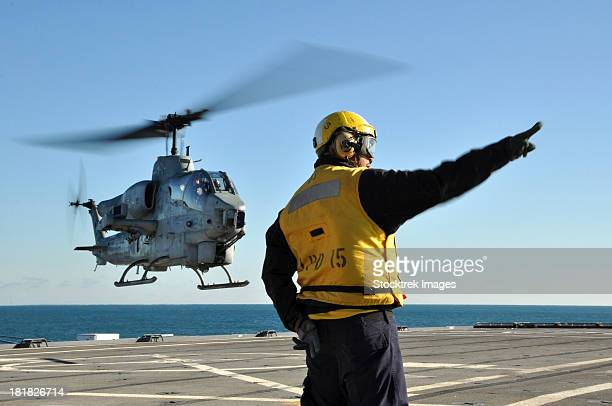 An AH-1W Super Cobra helicopter lifts off from USS Ponce.
