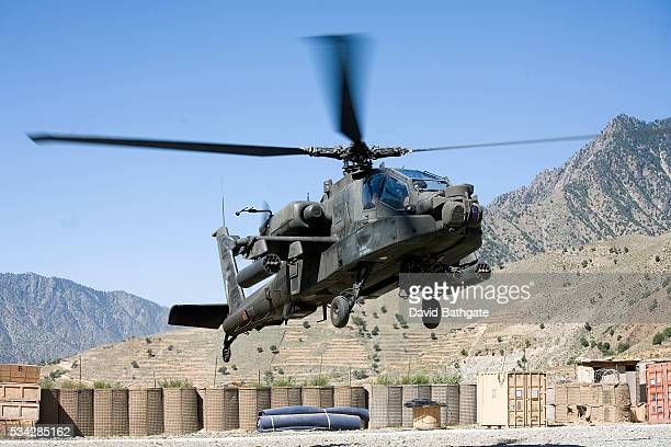 An AH64 Apache attack helicopter lands at Forward Operating Base Naray in northeastern Afghanistan Apaches provide security for US military resupply...