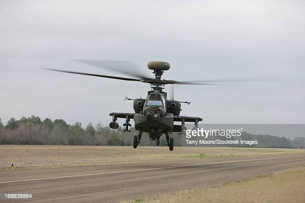 An AH-64 Apache helicopter in midair, Conroe, Texas.