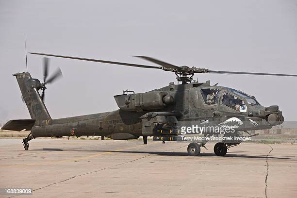 An AH-64 Apache helicopter returns from a mission over Northern Iraq during Operation Iraqi Freedom.