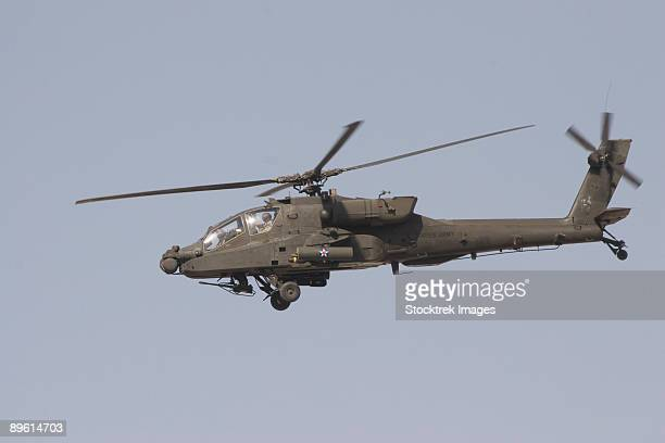 An AH-64 Apache in flight over the Baghdad Hotel in central Baghdad, Iraq.