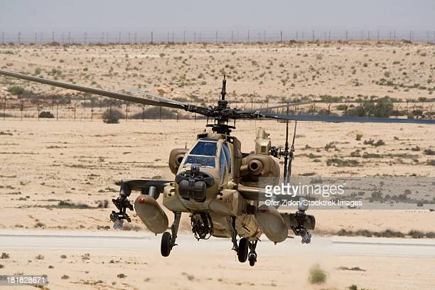 An AH-64A Peten attack helicopter of the Israeli Air Force hovers over the runway at Ramon Air Force Base, Israel.