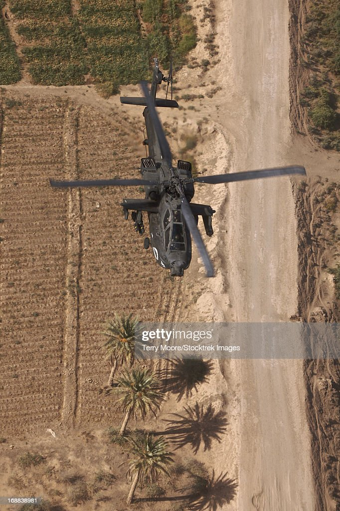 An AH-64D Apache Longbow helicopter in flight over Northern Iraq. : Stock Photo