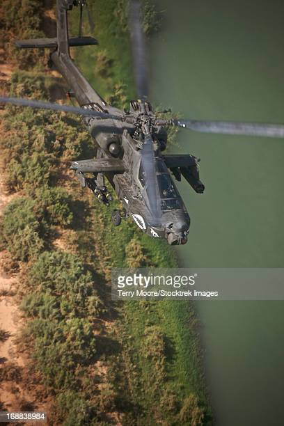 An AH-64D Apache Longbow helicopter in flight over Northern Iraq.