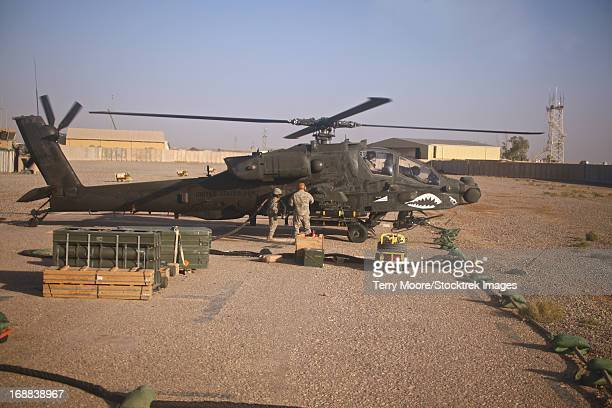 An AH-64D Apache Longbow helicopter refueling at a Forward Area Refueling Point in Tikrit, Iraq.