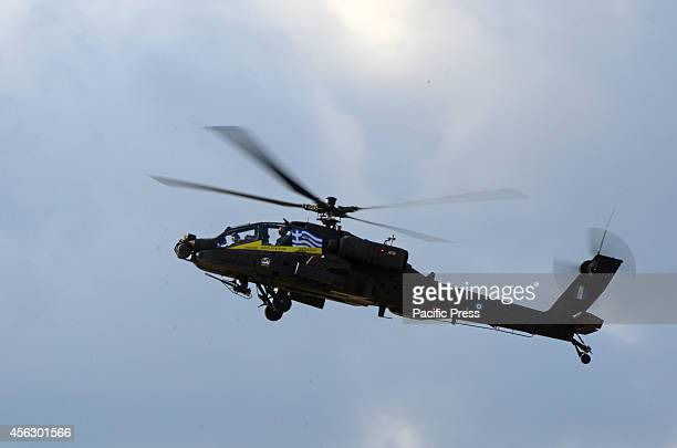 An AH64D Lolgbow Apache that belongs to the Greek Army Aviation Display Team Pegasus pass over the spectators during marked the 3rd and last day of...